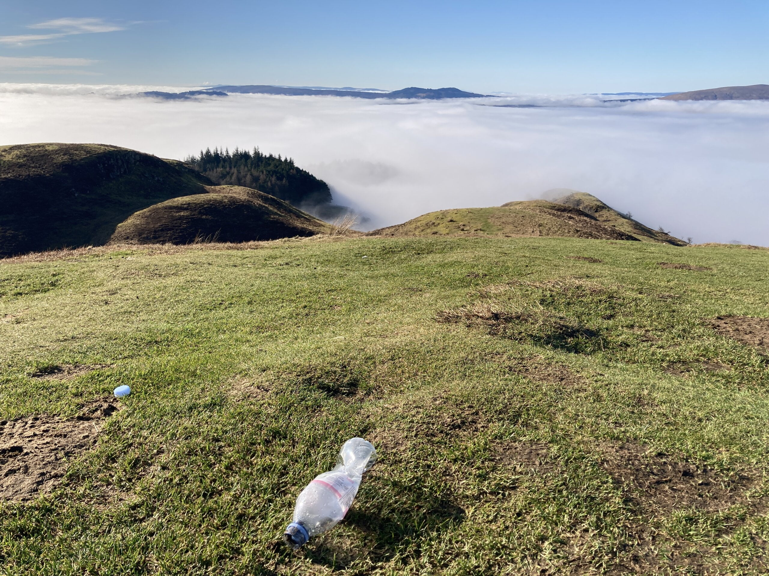 plastic water bottle littered on Conic Hill